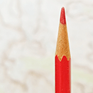 Red editing pencil in front of a topo map.