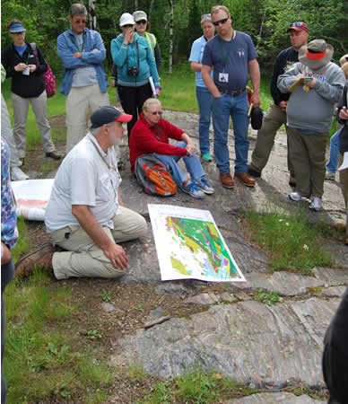Looking at outcrop with map