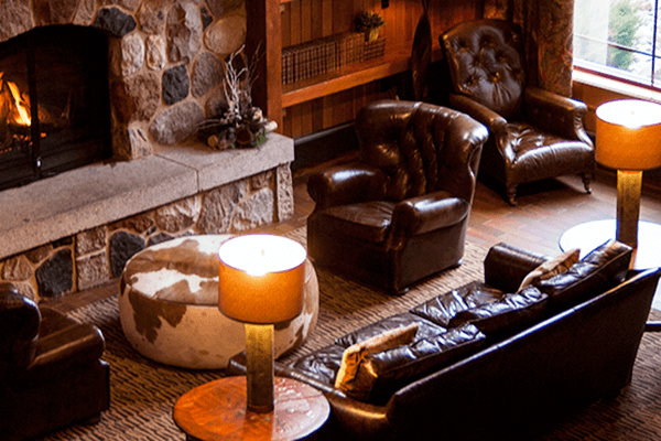 Fireplace and leather furniture.
