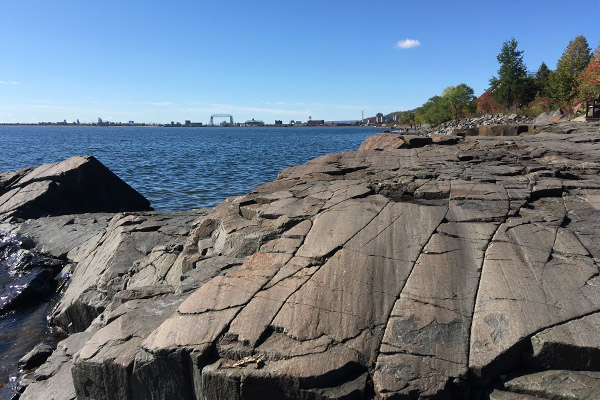 Rock slabs on a lakeshore display glacial polishing and striations.